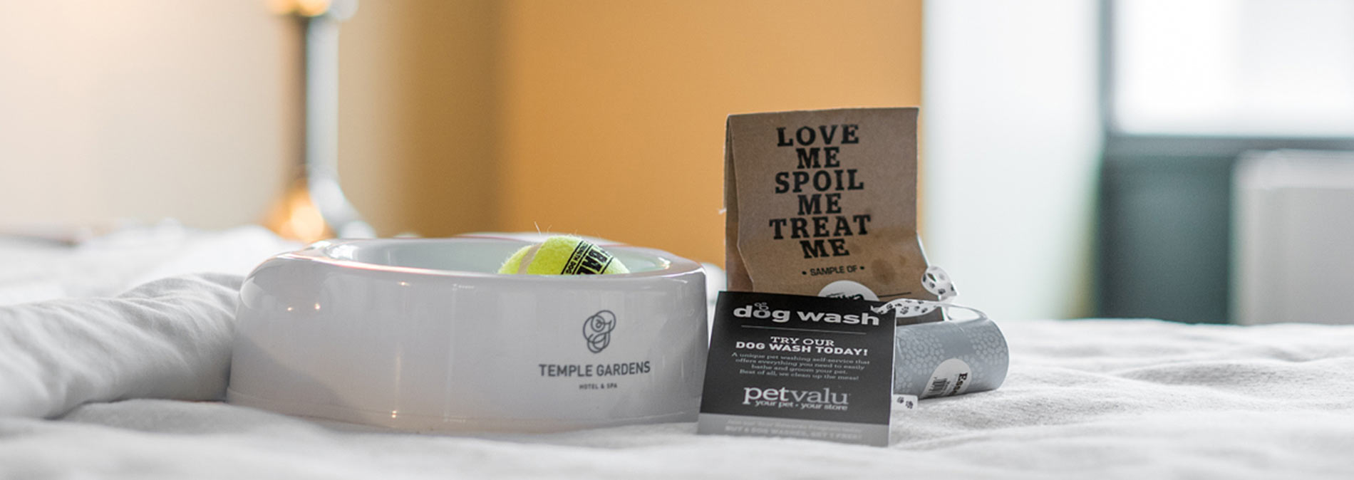 food bowl with hotel logo and treats for pets