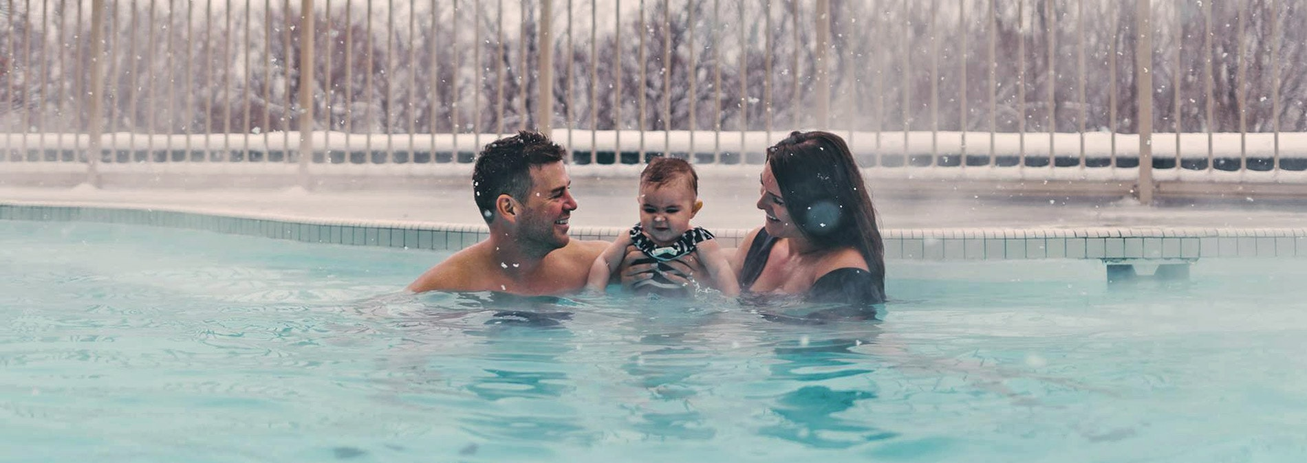 Couple with baby at Temple Gardens Hotel & Spa mineral pool