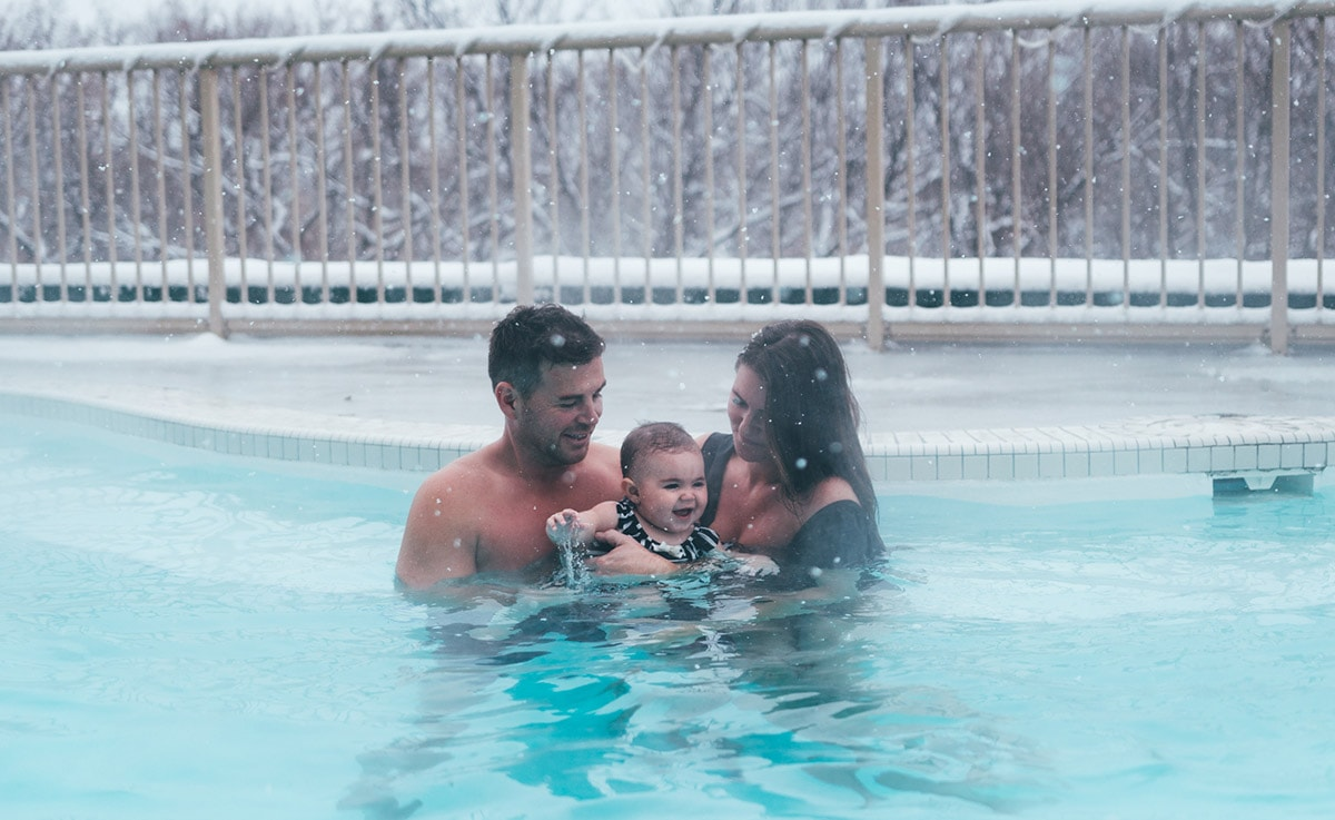Couple with baby in guestroom at Temple Gardens Hotel & Spa pool