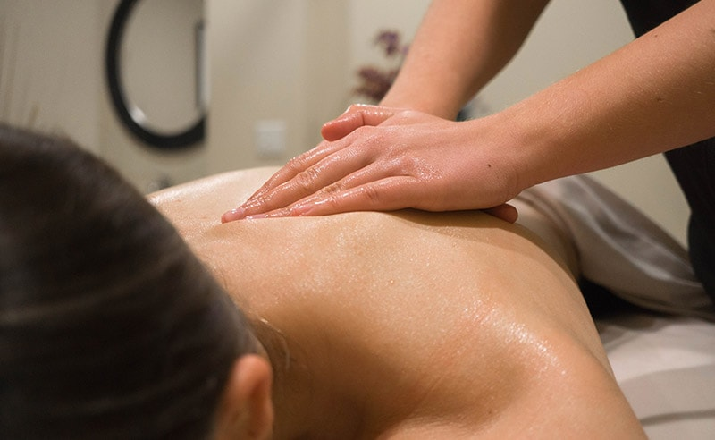 Woman having massage at spa