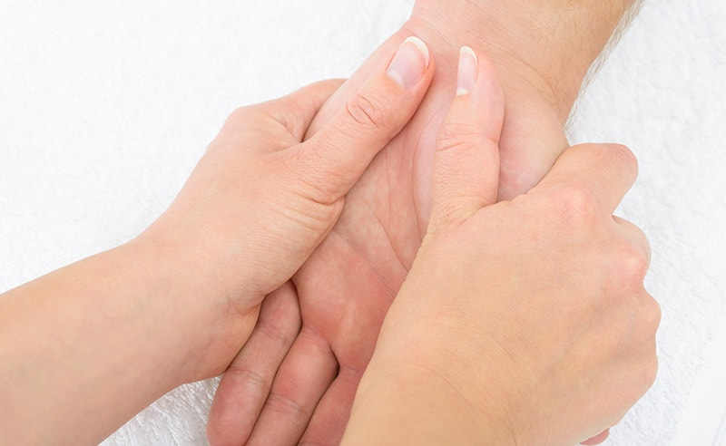 reflexology treatment on hand