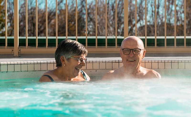 Senior couple in Temple Gardens pool